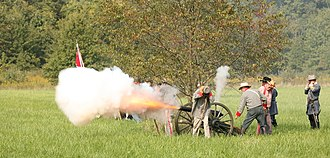 American Civil War reenactment - Confederate artillery reenactors fire on Union troops during a Battle of Chickamauga reenactment in Danville, Illinois.