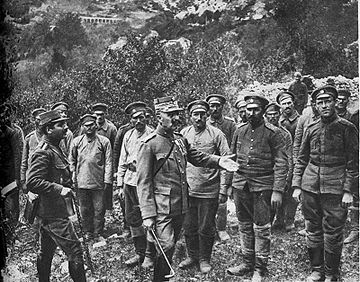 Colonel Christodoulou of the National Defence Army Corps interrogates Bulgarian prisoners, September 1918. Colonel Christodoulou interrogates Bulgarian POWs.jpg