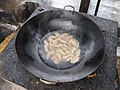 Cooking with a wok on an outdoor stove 1.jpg