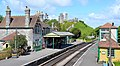 Corfe castle station with Corfe castle in background.jpg
