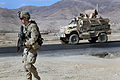 Defense.gov News Photo 101221-A-6521C-049 - U.S. Army Pfc. Samuel Ford walks next to his vehicle in order to clear and document culverts along a highway in the Wardak province Afghanistan.jpg