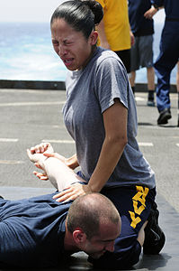 Defense.gov News Photo 110510-N-RC734-189 - Petty Officer 2nd Class Jaqueline Rodriguez subdues a simulated suspect after being sprayed with oleoresin capsicum spray also known as pepper.jpg