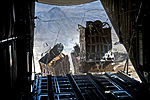 Defense.gov News Photo 111123-F-CP197-004 - Crews drop pallets of food and supplies from a U.S. Air Force C-130 Hercules aircraft over Bagram Airfield in Kandahar Afghanistan on Nov. 23.jpg