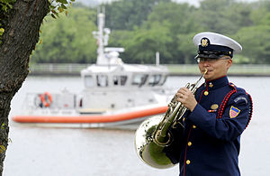 United States Coast Guard Band - A Coast Guard bandsman warms-up prior to a change-of-command ceremony in 2010.