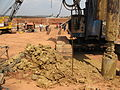 Digging holes for the piles (left the clay that is dug up) (6897502049).jpg