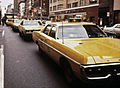 Dodge Polara and other Yellow Cabs in 1973 (NYC).jpg