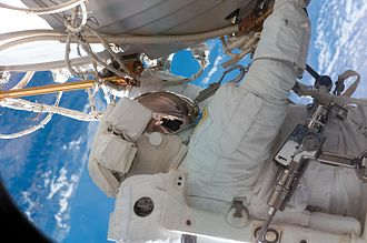 Douglas H. Wheelock - Wheelock working on the outside of the International Space Station during STS-120.