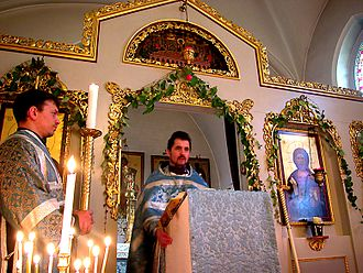 Gospel (liturgy) - Priest reading the Gospel during the Divine Liturgy.