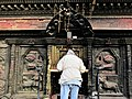 Early morning devotee at Bhairab Nath Temple, Bhaktapur.jpg