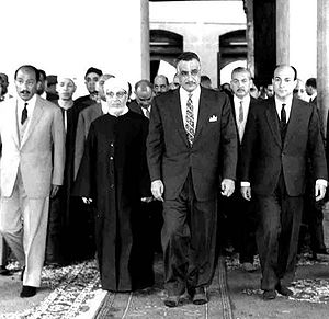Hassan Mamoun - Mamoun (second from left in the forefront) with Egyptian government officials in the al-Azhar Mosque before Friday prayers in the last week of Ramadan, January 1966. President Gamal Abdel Nasser is standing to Mamoun's left and future president Anwar Sadat to his right