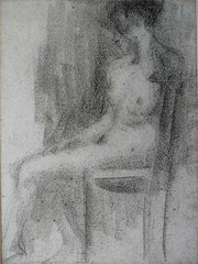 Nu feminino sentado