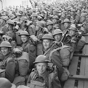 3rd Canadian Division - Men of the 3rd Canadian Division are carried ashore on a tender, having disembarked from a troopship at Gourock in Scotland, 30 July 1941.