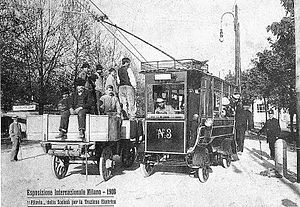 Cantono Frigerio system - A trolleybus passes a cart at the Milan International, 1906