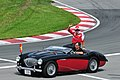 F1 Drivers Parade Fernando Alonso in an Austin Healey.jpg