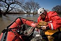 FEMA - 40685 - Valley Water Rescue member, Bud Myers scents his search dog in North Dakota.jpg