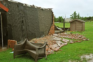 Masonry veneer - A brick veneer wall destroyed by a tornado.
