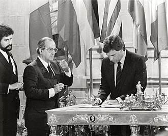 Felipe Gonzalez signing the treaty of accession to the European Economic Community on 12 June 1985 Felipe Gonzalez firma el Tratado de Adhesion de Espana a la Comunidad Economica Europea en el Palacio Real de Madrid. Pool Moncloa. 12 de junio de 1985.jpeg