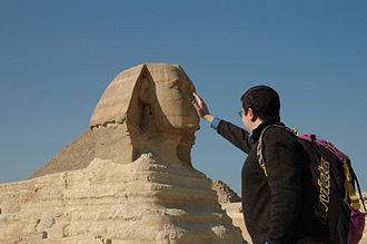 Size - Forced perspective illusion wherein the perceived size of the Sphinx next to a human is distorted by the incomplete view of both, and the appearance of physical contact between the two.