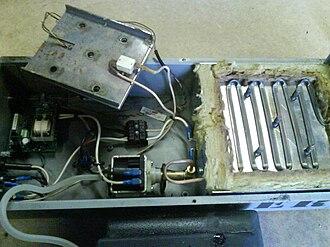 Fog machine - Interior view of a fog machine, showing the pump and heat exchanger.
