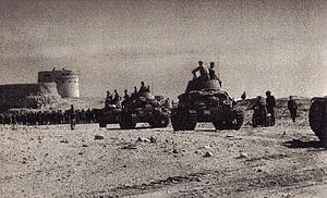 Action at Mechili, 24 January 1941 - Italian tanks with Fort Mechili in the background.