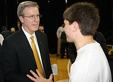 Fran McCaffery talks with an Iowa student after his introduction as the new head basketball coach at The University of Iowa.