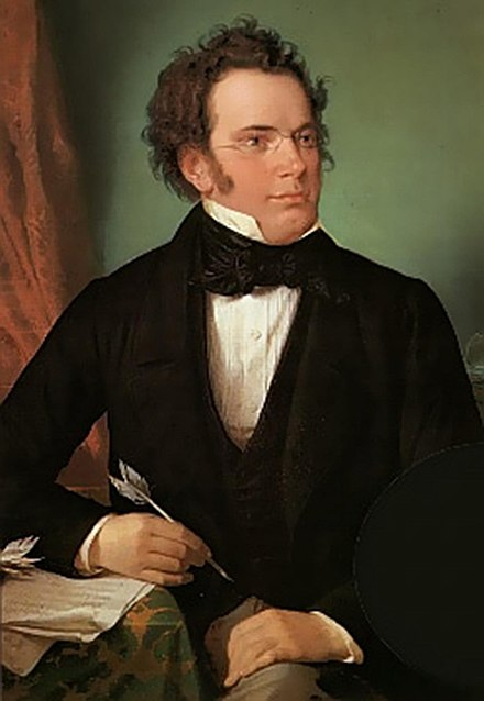 Oil painting of Franz Schubert by Wilhelm August Rieder (1875), made from his own 1825 watercolour portrait Signature written in ink in a flowing script Franz Schubert by Wilhelm August Rieder 1875.jpg