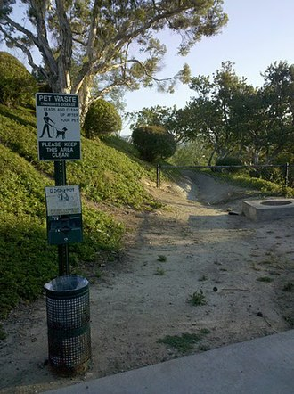 Dog walking - Many cities encourage dog walkers to pick up after their pets by providing free baggies along popular paths or in parks, such as this one in Yorba Linda, California.