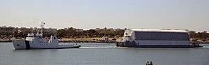 Freedom Star pulls Pegasus barge through Port Canaveral.jpg