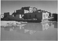 "Full side view of adobe house with water in foreground, ""Acoma Pueblo (National Historic Landmark, New Mexico)."", 1933 - - NARA - 519831.TIF"
