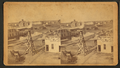 General view of Great Bend showing wind mill, implement store, homes, other buildings, from Robert N. Dennis collection of stereoscopic views.png