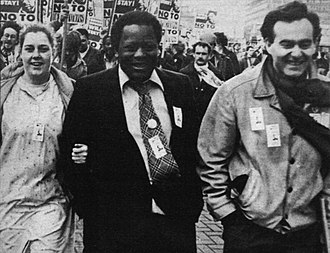 Revolutionary Communist Party (UK, 1978) - George Roucou, marching to freedom, with his wife Kay and Workers Against Racism organiser Charles Longford