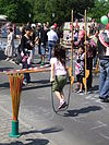 A young girl playing on a jump rope.