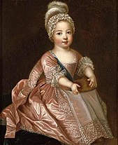 Louis XV as a boy wearing a pink dress.