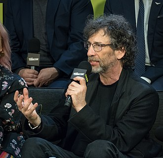 Neil Gaiman - Gaiman on a panel about the Good Omens TV series at New York Comic Con in 2018
