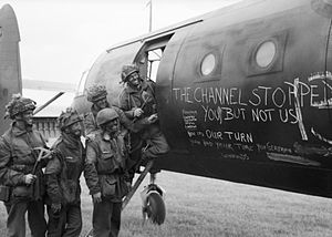 6th Airlanding Brigade (United Kingdom) - British airborne troops admire the graffiti chalked on the side of their glider as they prepare to fly out as part of the second drop on the night of 6 June 1944.