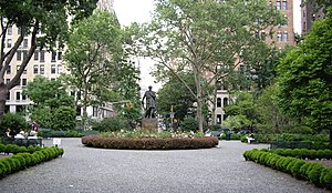 Gramercy Park - The view from the south gate of Gramercy Park, looking north from Gramercy Park South (East 20th Street), with the statue of Edwin Booth in the center. The Gramercy Park Hotel is visible in the left background. (May 2007)