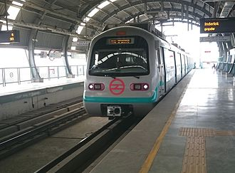 Green Line (Delhi Metro) - A new train being launched in the opening of the Kirti Nagar branch in 2011.