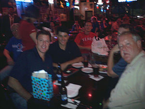2010 Texas Rangers season - New Rangers owner Chuck Greenberg (left front) met with fans at almost every home game and participated in other fan events like this August watch party in Arlington, Texas.