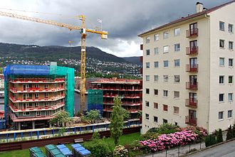 Gyldenpris - Apartment building from the 1950s and new buildings being built in May 2011.