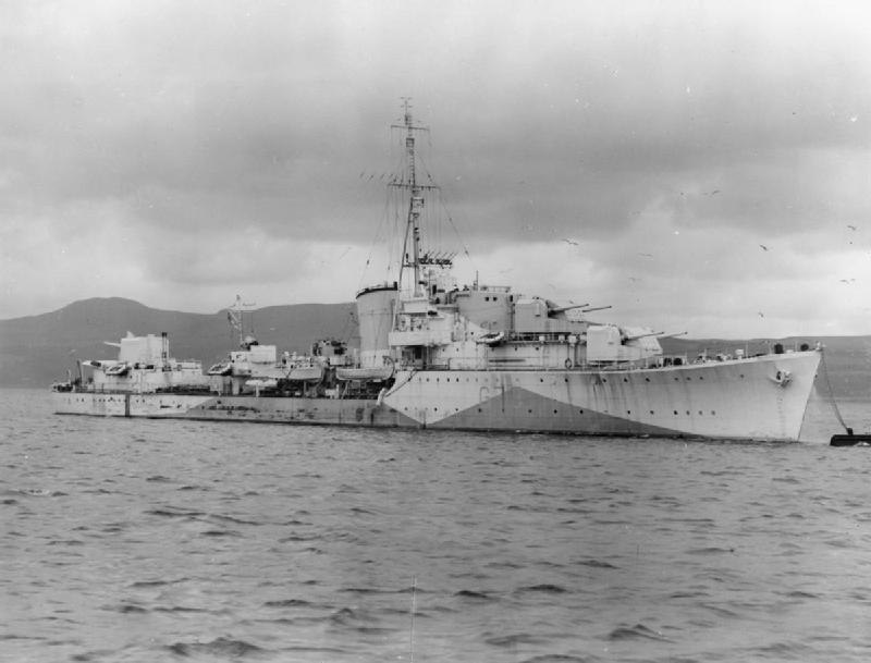 a black and white photograph of a warship at sea
