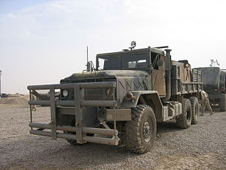 Improvised vehicle armour - A U.S. Army 5-ton cargo truck with improvised armour on the doors, rear gunner's box, and an improved bumper.
