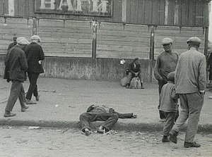 Holodomor - Passers-by and the corpse of a starved man on a street in Kharkiv, 1932