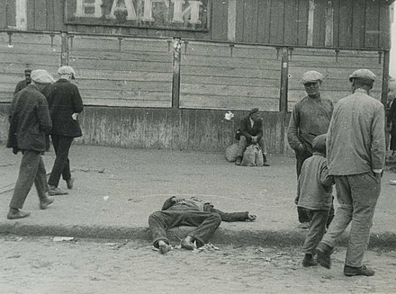 A starved man on the streets of Kharkiv, 1933. Collectivization of crops and their confiscation by Soviet authorities led to a major famine known as the Holodomor. HolodomorUcrania9.jpg