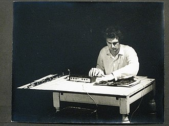 Hugh Davies (composer) - Black and white photograph of Hugh Davies with Shozyg I Uher mixer and clarinet