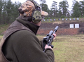 Hunter in pre-firing position shooting range Sweden 01.png
