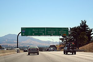 Gantry (road sign) - A tubular piped gantry in California.
