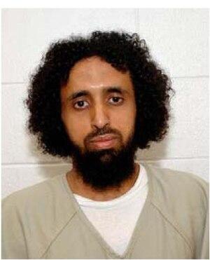 Mashur Abdallah Muqbil Ahmed Al Sabri - Mashur Abdallah Muqbil Ahmned al-Sabri, wearing a white uniform issued to compliant individuals.