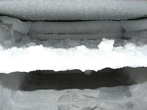 Iced freezer, defrosting
