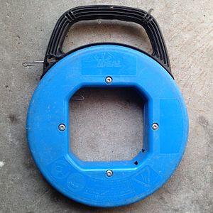 Fish tape - A 75' steel fish tape.