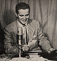 In Manchester, New Hampshire, Donn Tibbetts spins discs and reports sports over WFEA, 1953.jpg